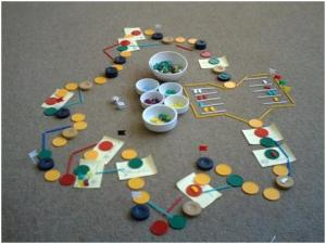 One of the earlier mock-ups of Poseidon's Wrath. Casino chips and plastic sticks proved to be useful for flexible prototyping and playtesting.